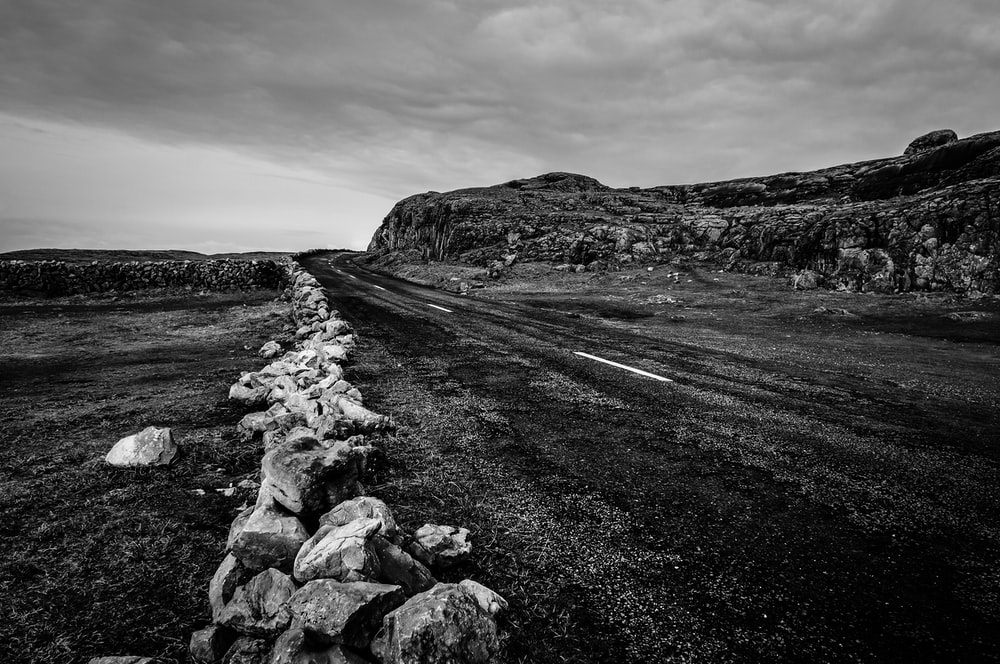 grayscale photo of rocky road