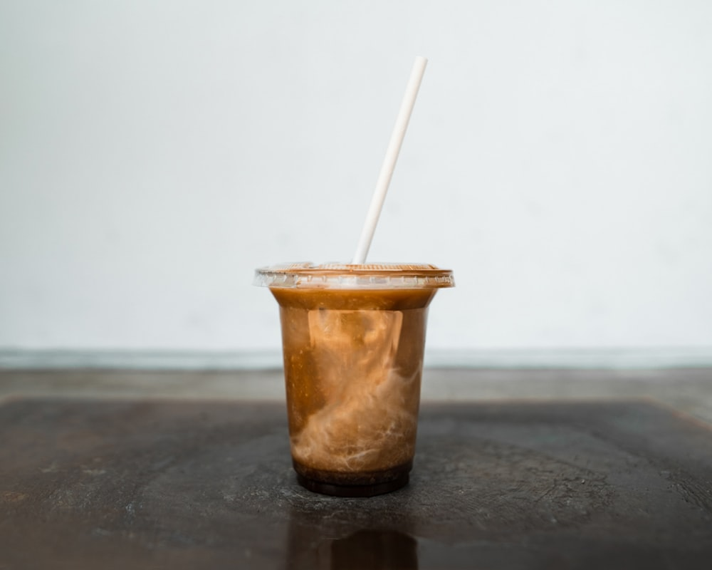 brown and white plastic cup