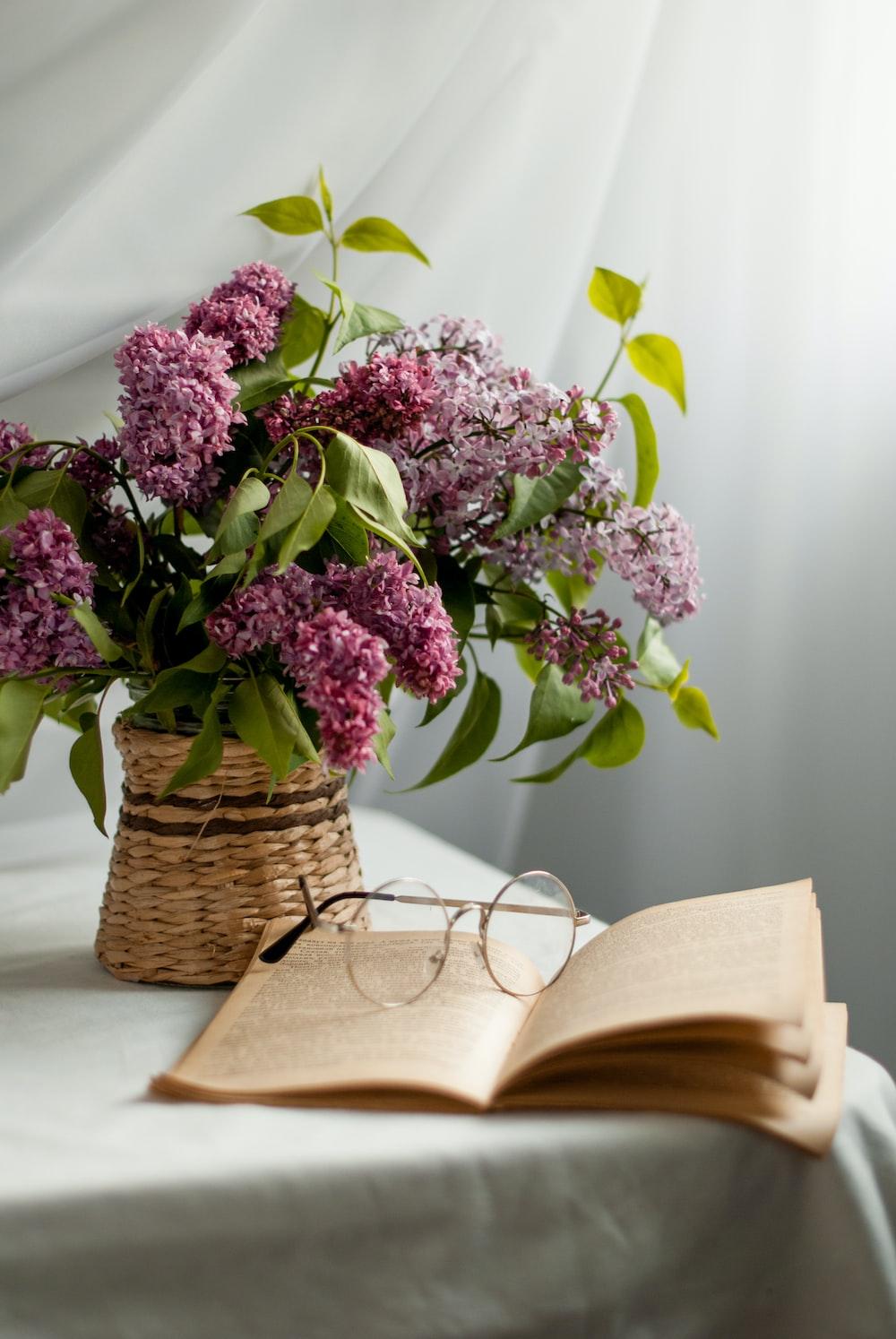 purple flowers on brown woven basket
