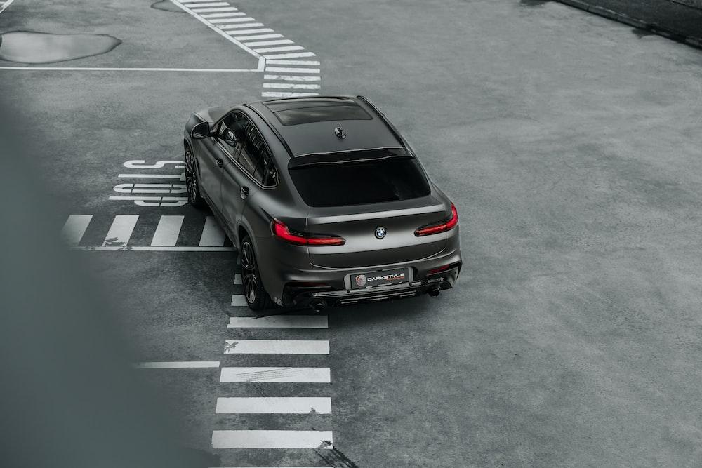 black porsche 911 parked on parking lot