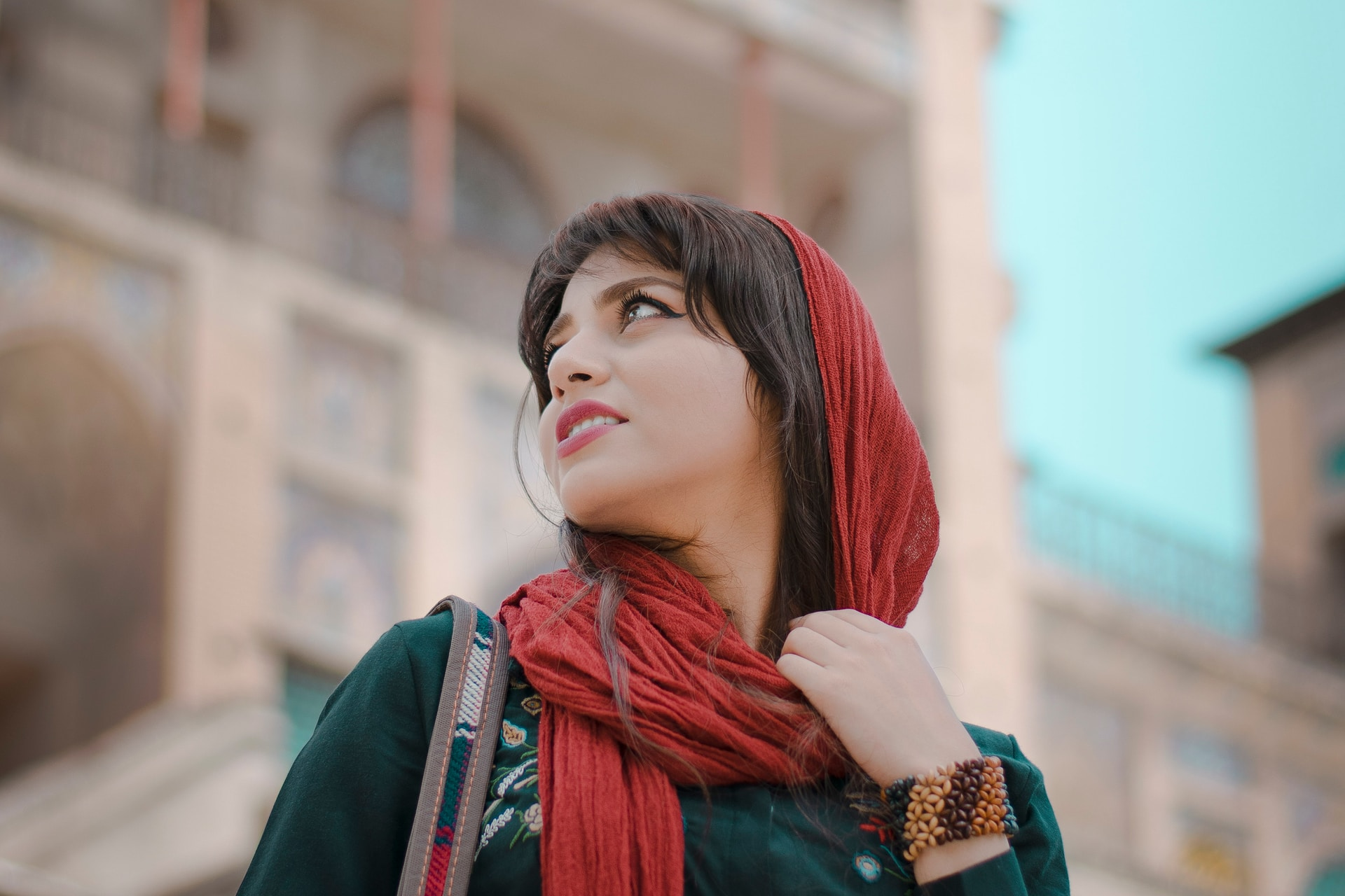 woman in red scarf and black long sleeve shirt