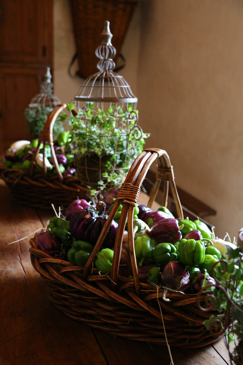 brown woven basket with green and purple flowers