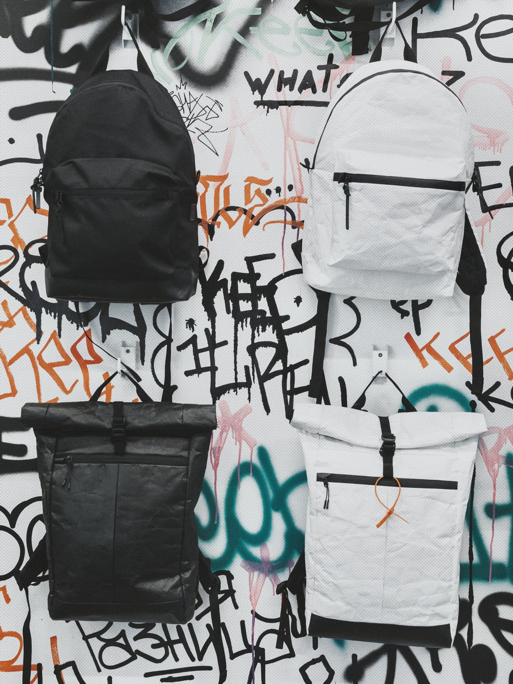 black and white backpack on white and blue textile