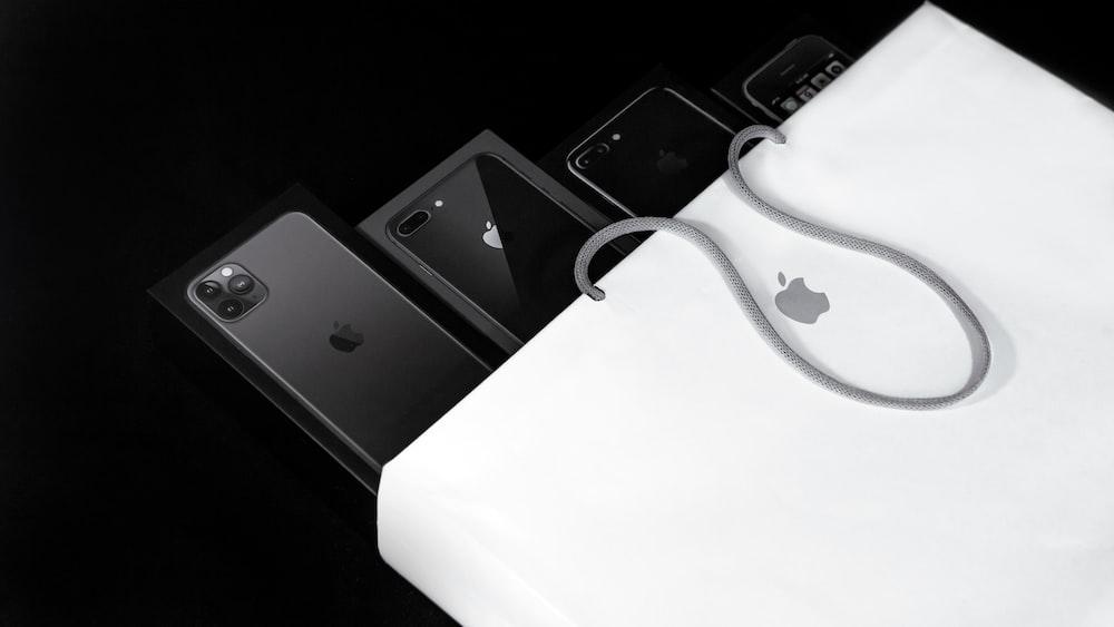 black iphone 7 on white macbook
