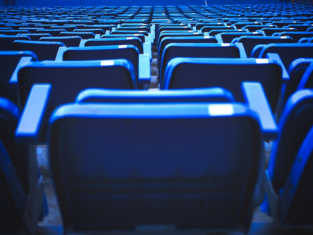blue and black chairs in stadium