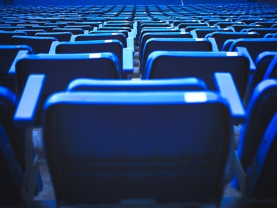 blue and black chairs in stadium real madrid zoom background