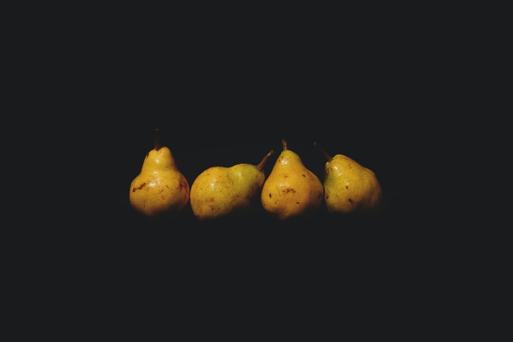 3 yellow fruit with black background