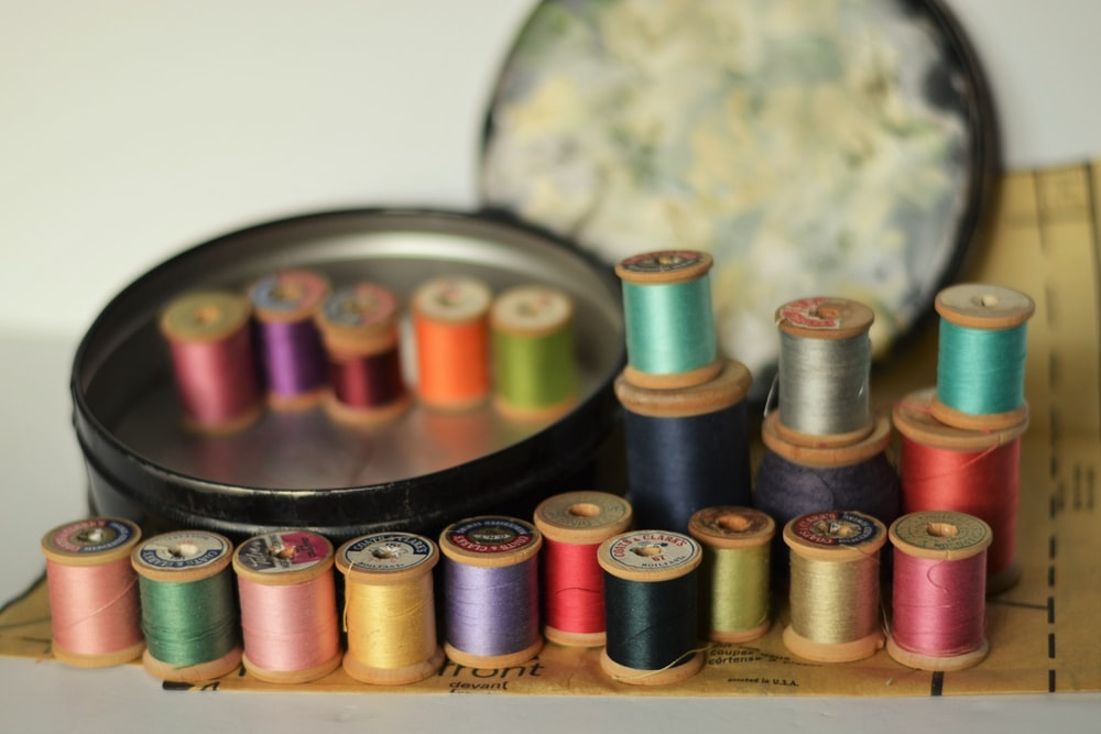 brown and green thread spool