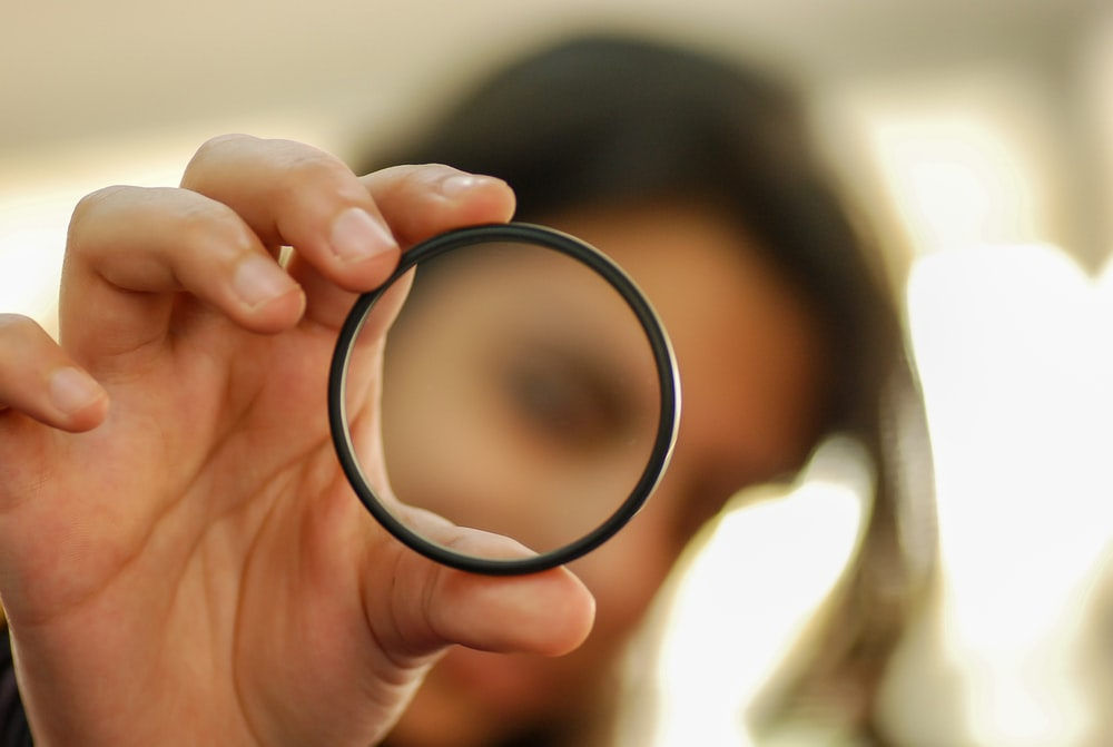 person holding black round frame