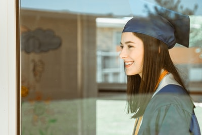 woman in blue academic gown commencement zoom background