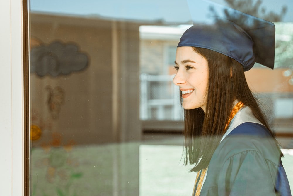 woman in blue academic gown