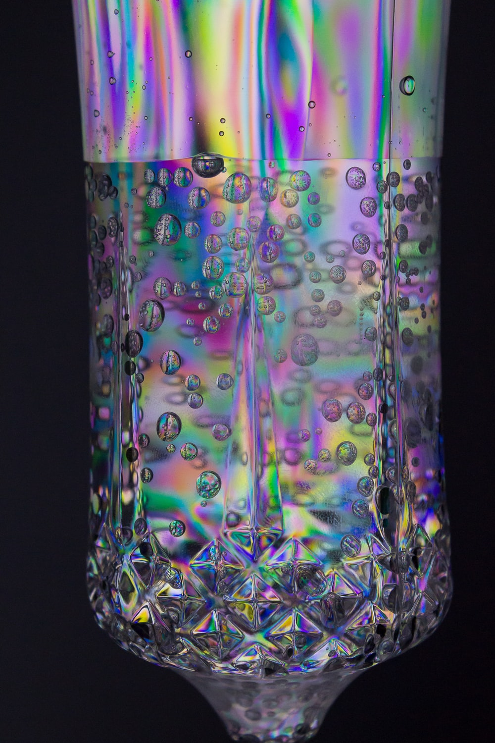 clear glass jar with green and purple liquid