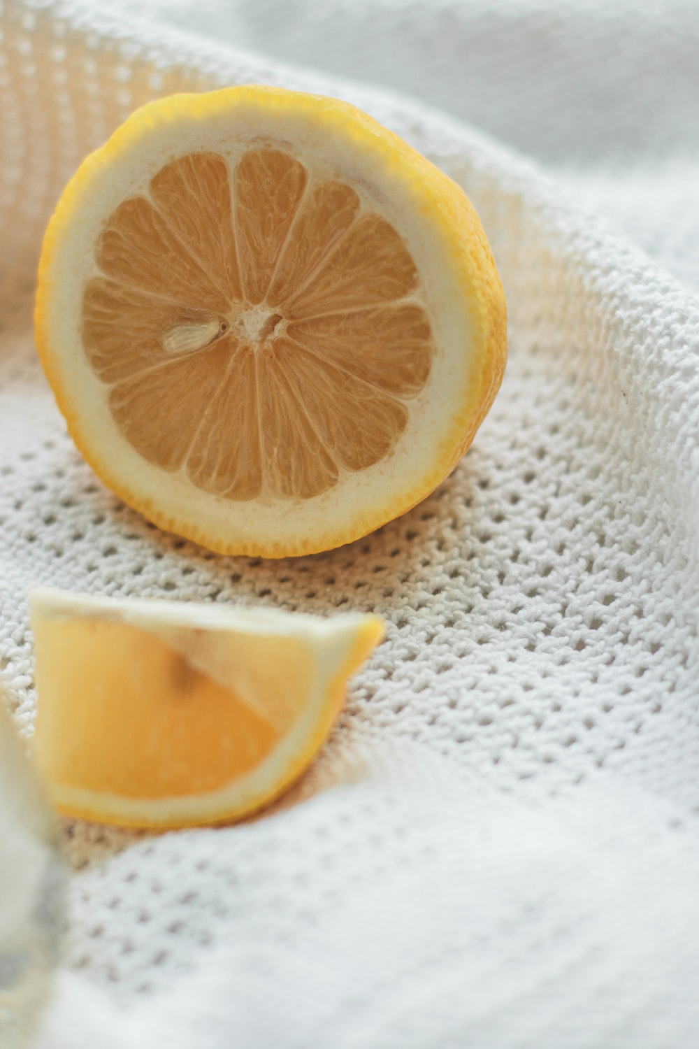 sliced lemon on white textile
