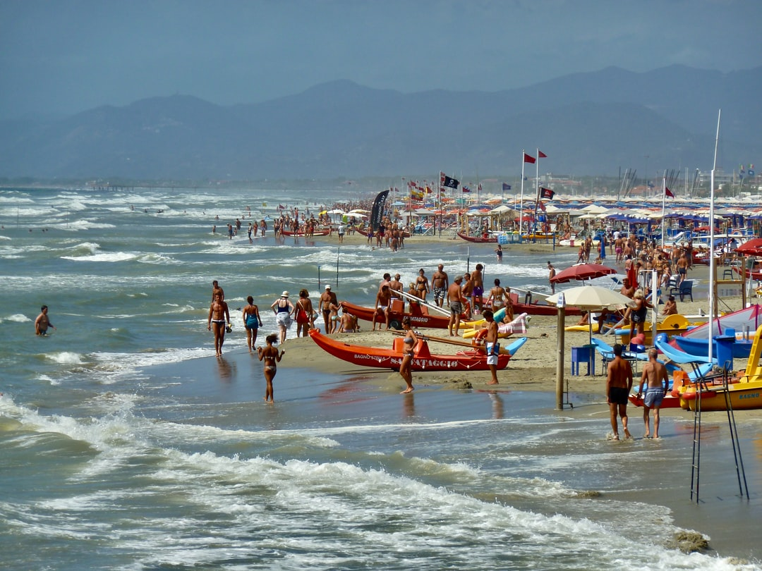 Crowded beach on a stormy day in the tuscany.