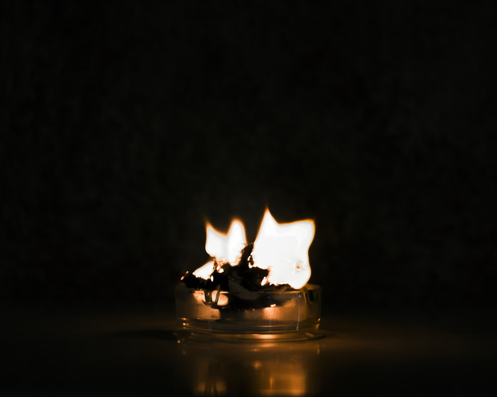 fire in clear glass with black background