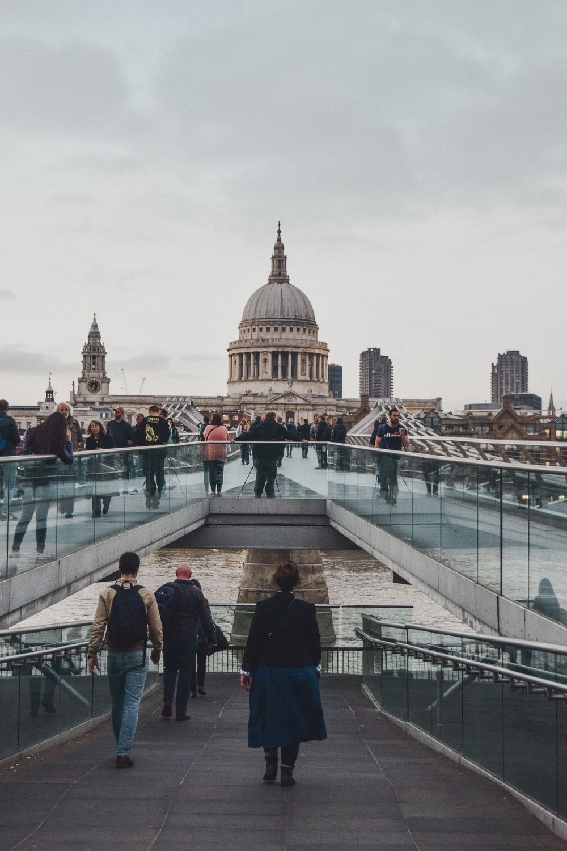 people walking on white concrete bridge during daytime