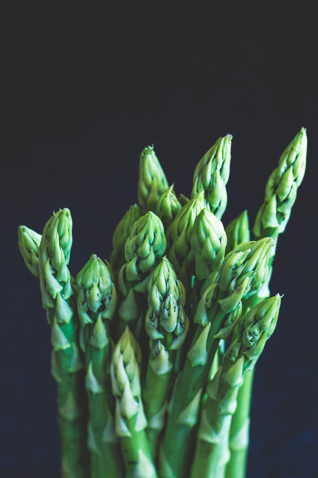 Fresh green bio quality asparagus from the local farmers market. Support your local farmers, without intermediaries and big global food companies. Made with Canon 5d Mark III and analog vintage lens, Leica APO Macro Elmarit-R 2.8 100mm (Year: 1993)