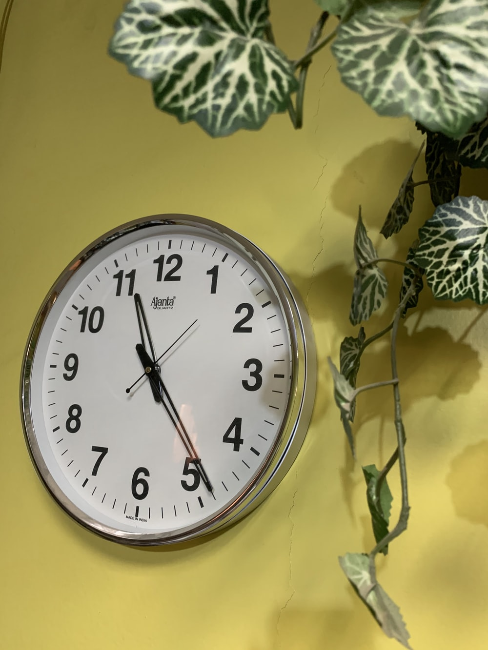silver round analog wall clock