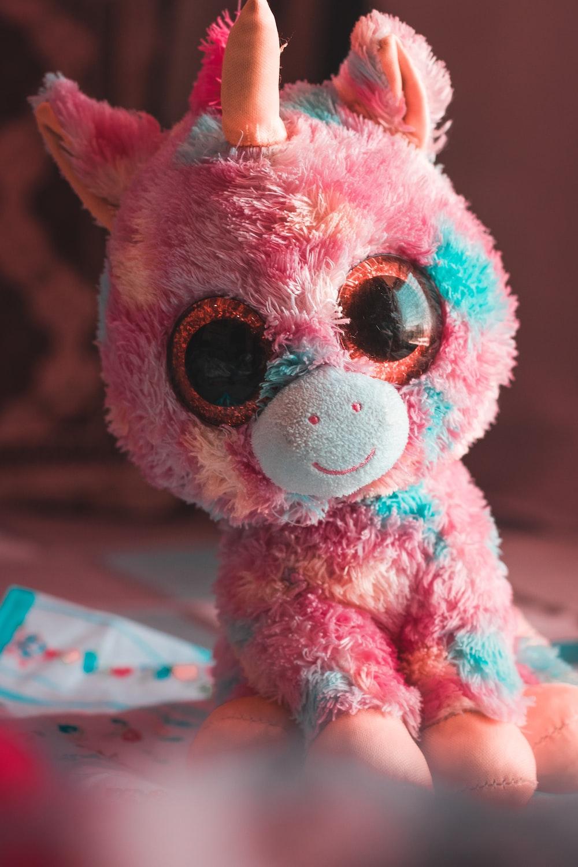 pink and white animal plush toy