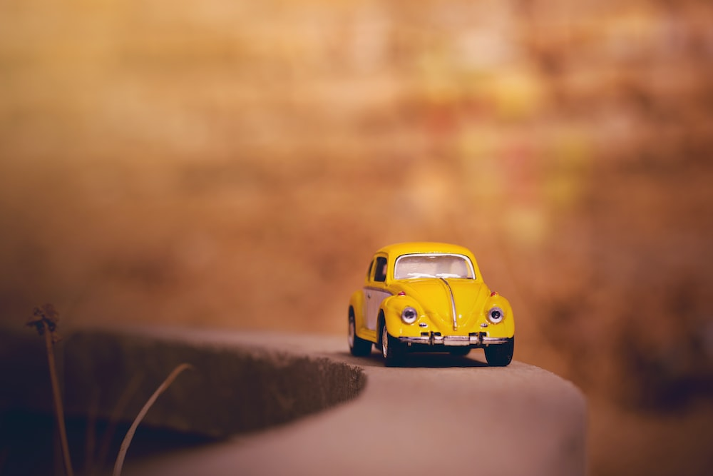 yellow and black car scale model