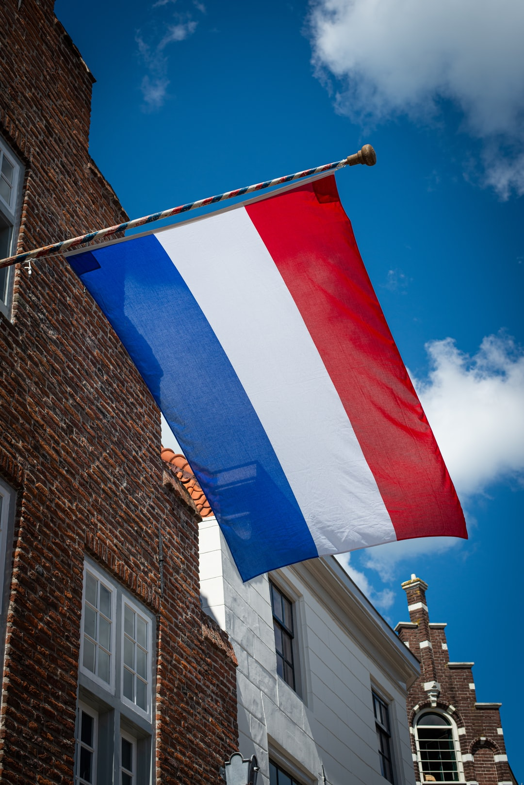 Dutch flag on old house during Liberation Day in Culemborg, The Netherlands