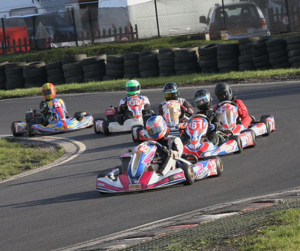 2 men riding go kart