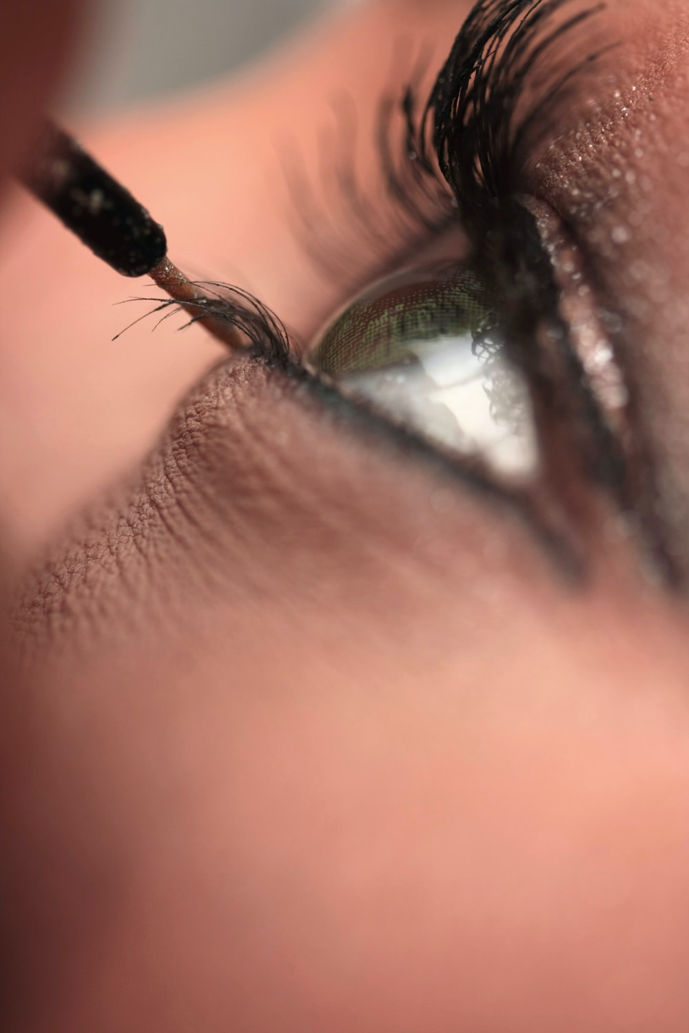 persons eye with black hair tie
