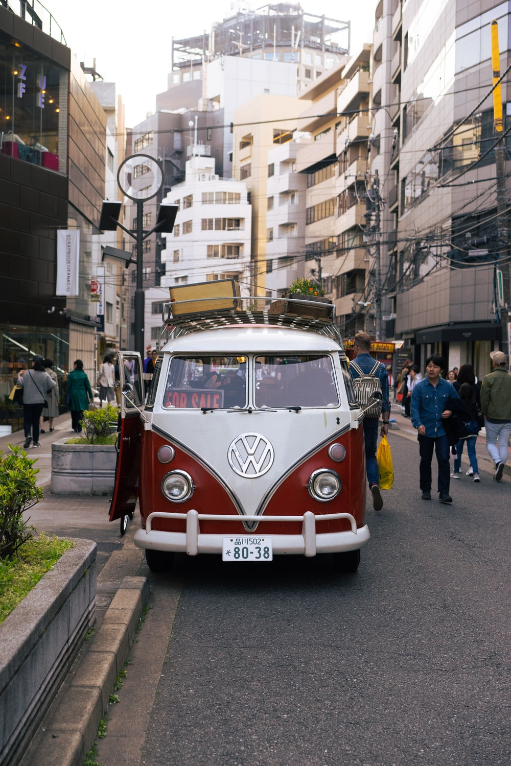 red and white volkswagen t-2 van on road during daytime