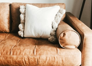 brown wooden framed white floral cushion armchair