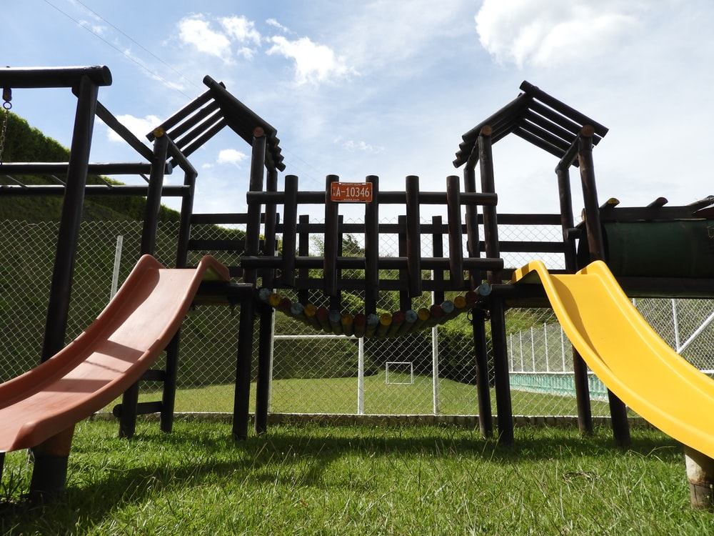 black wooden chairs on green grass field during daytime