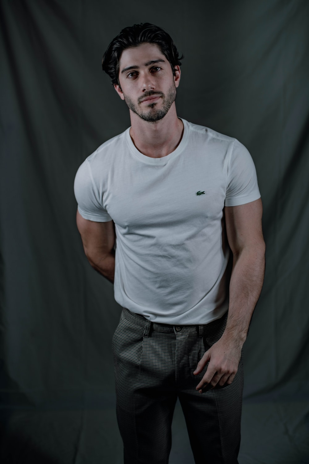 man in white crew neck t-shirt and black pants