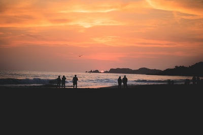silhouette of people on beach during sunset zihuatanejo teams background