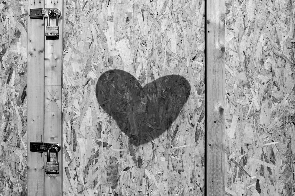 grayscale photo of heart shaped wall art