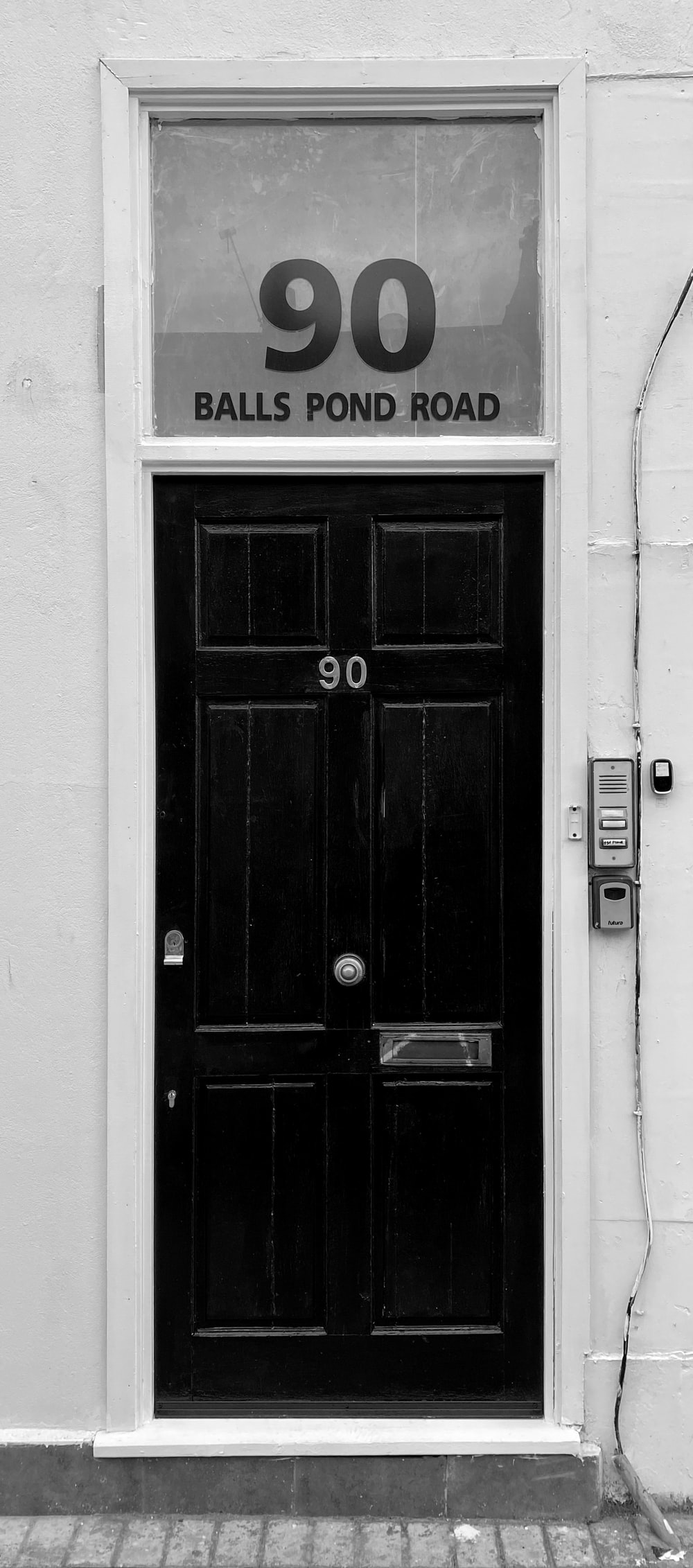 black wooden door with silver door lever