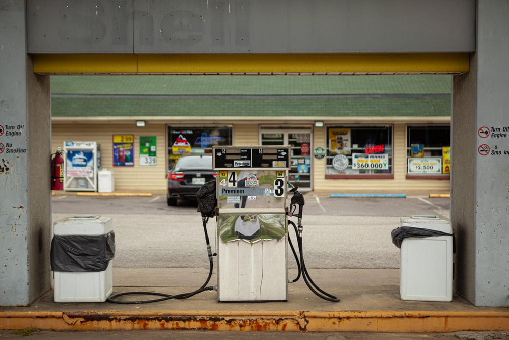 white and black gas pump