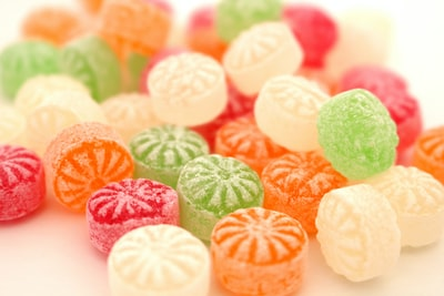 pink green and white candies candy teams background