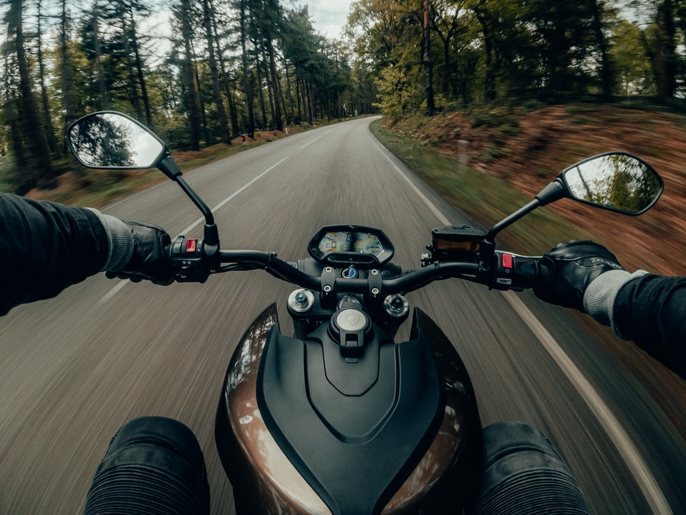 black and gray motorcycle on road during daytime