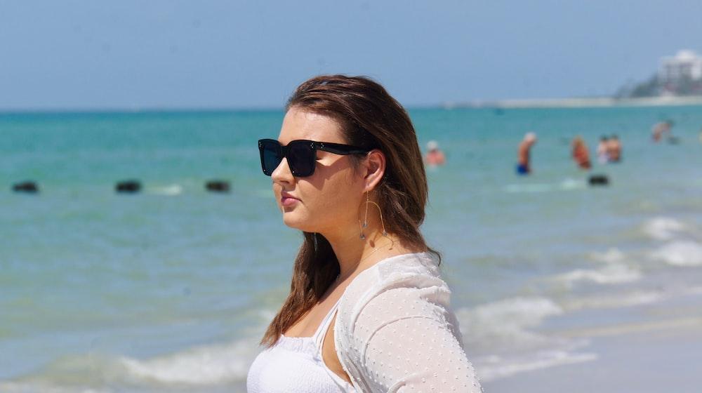 woman in white shirt wearing black sunglasses
