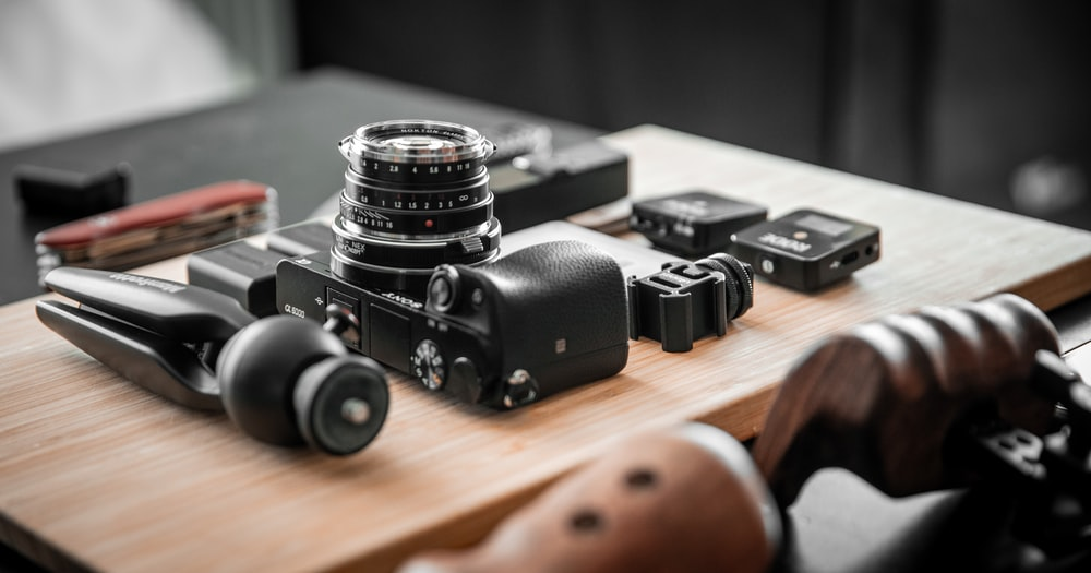black camera on brown wooden table