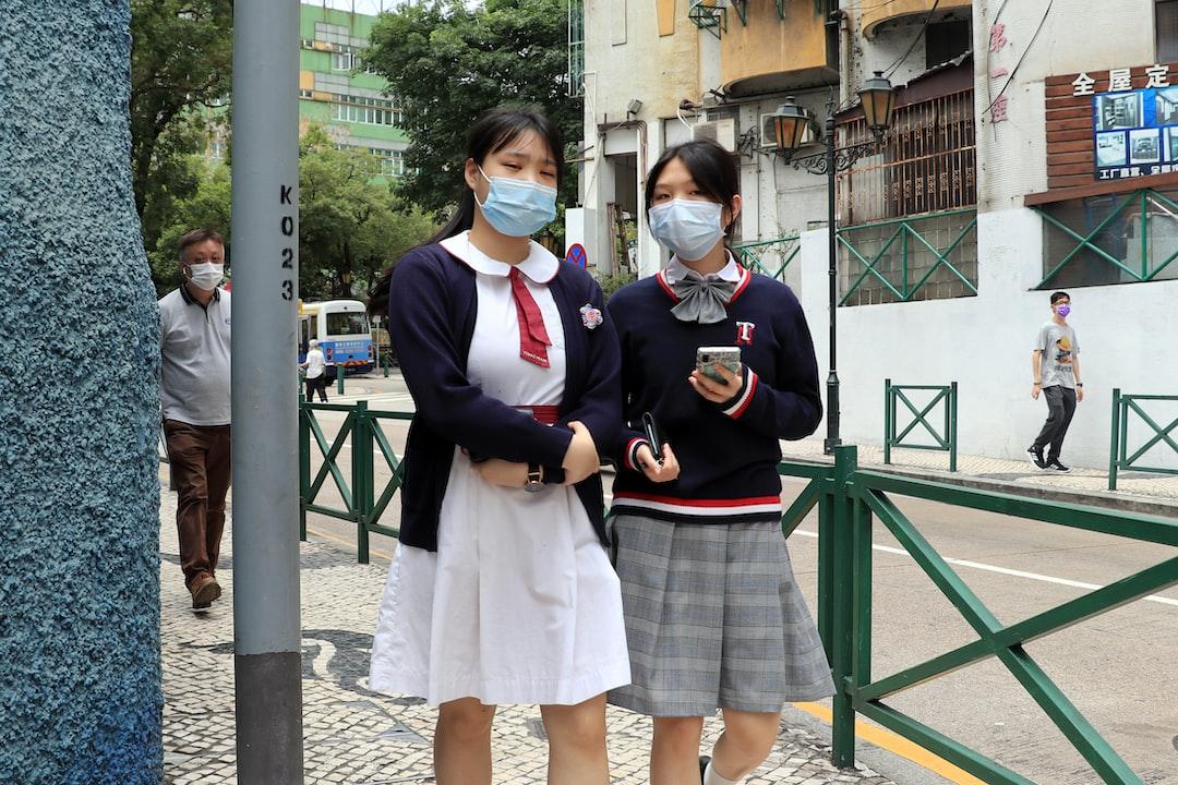Macau students return to School