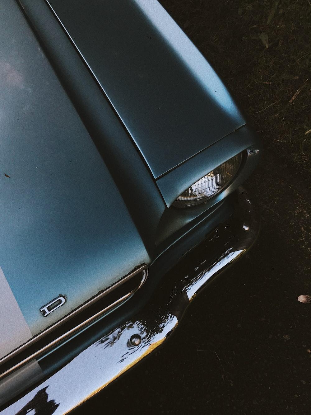 silver car on gray concrete floor