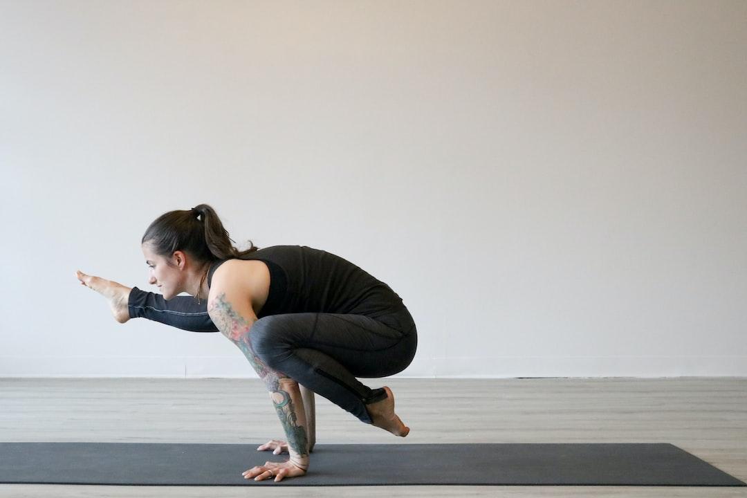 woman doing advanced yoga pose