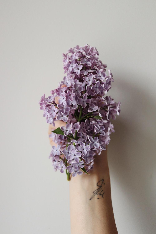purple flowers on brown wooden vase