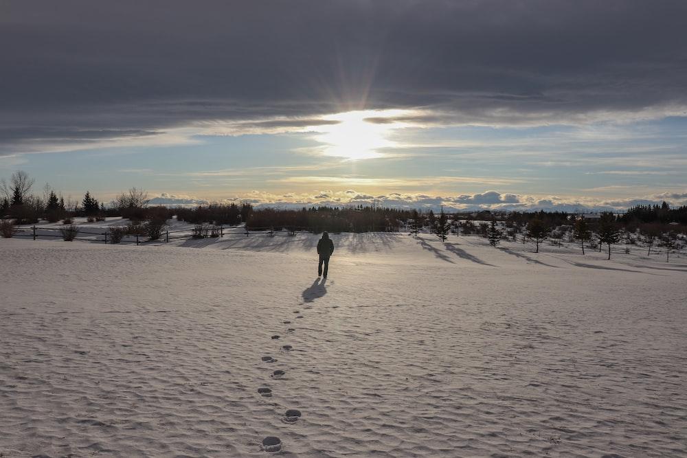 people walking on white sand during sunset
