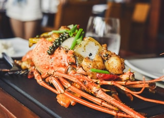 orange and white lobster on black tray