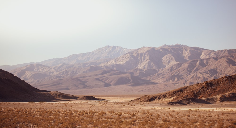brown and gray mountains under white sky during daytime