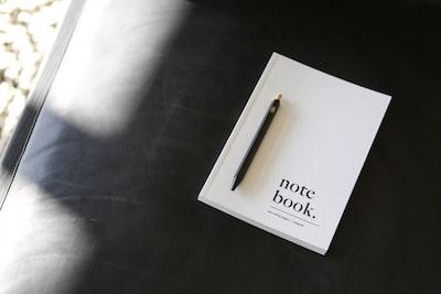 gold click pen on white box