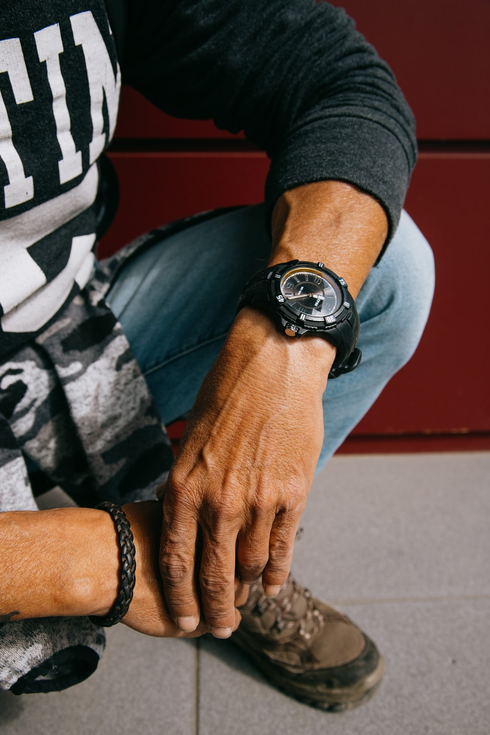 person wearing black and silver round analog watch