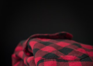 red and black checkered textile
