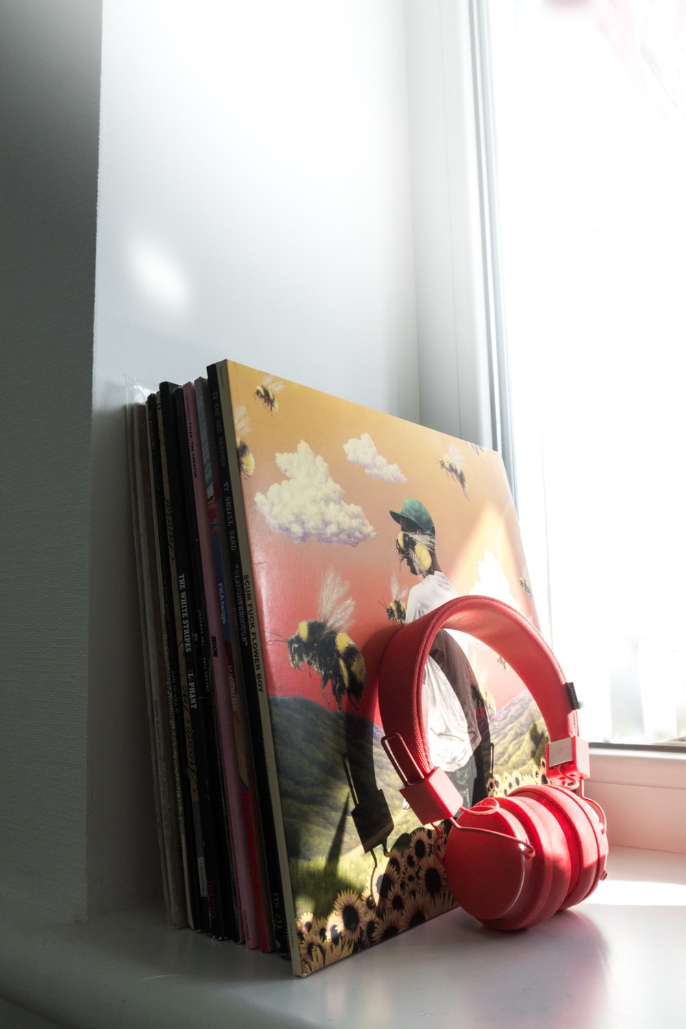red and white headphones on books